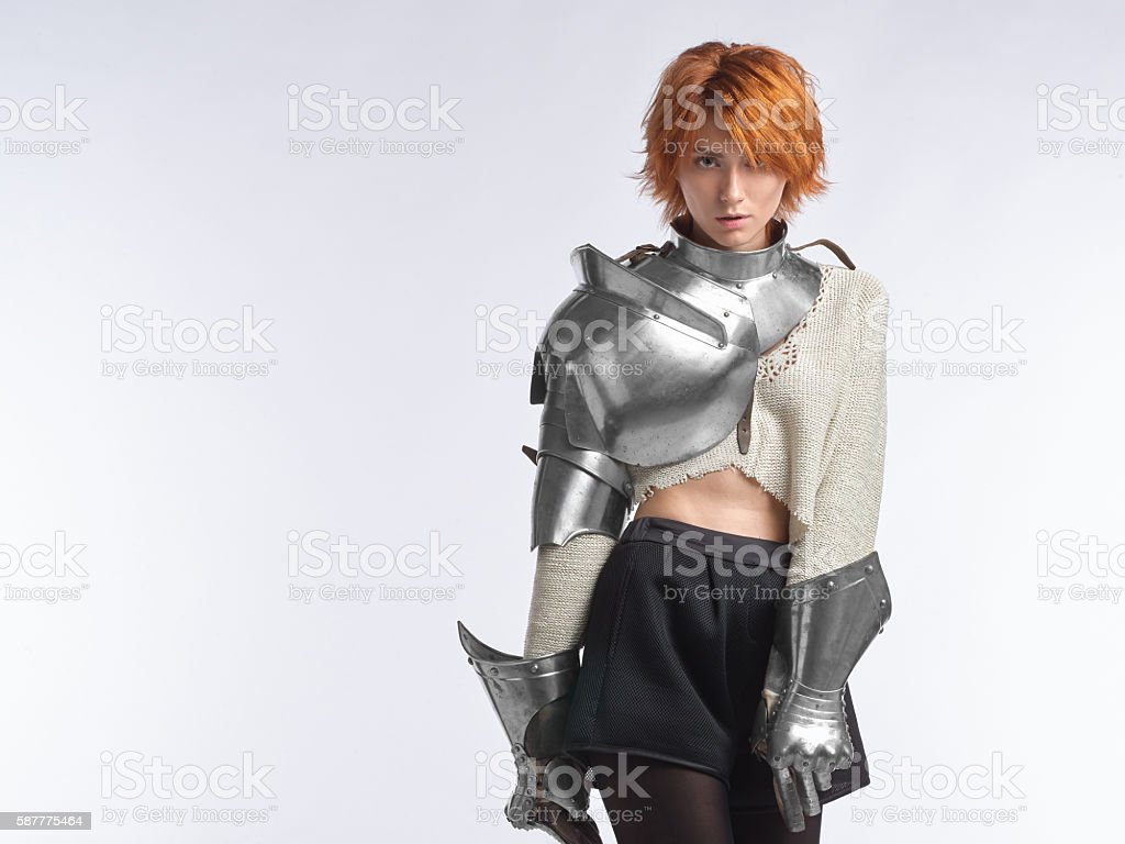 Portrait of a young girl in armor. stock photo
