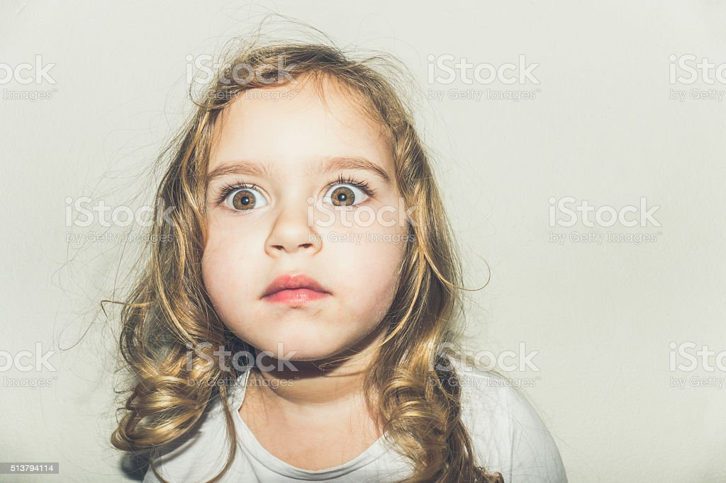 Portrait of a young girl looking surprised stock photo