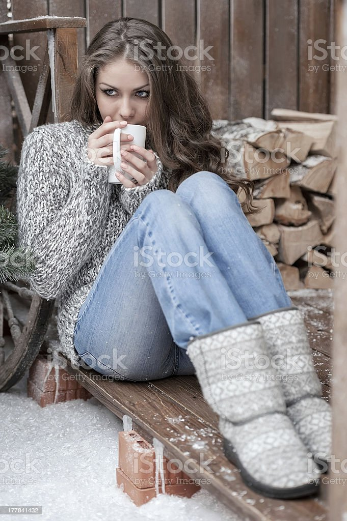 A portrait of a young girl sipping from a cup stock photo