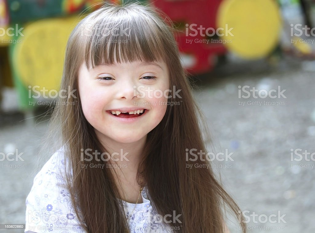 A portrait of a young girl smiling outside stock photo