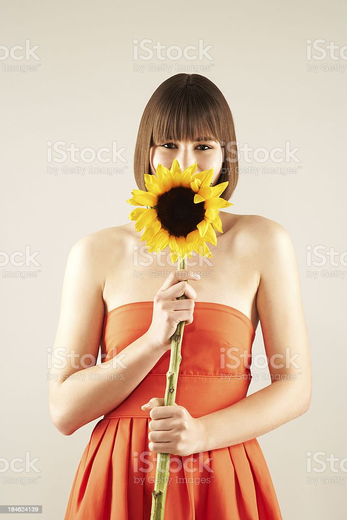 Portrait of a young gorgeous girl holding flower stock photo