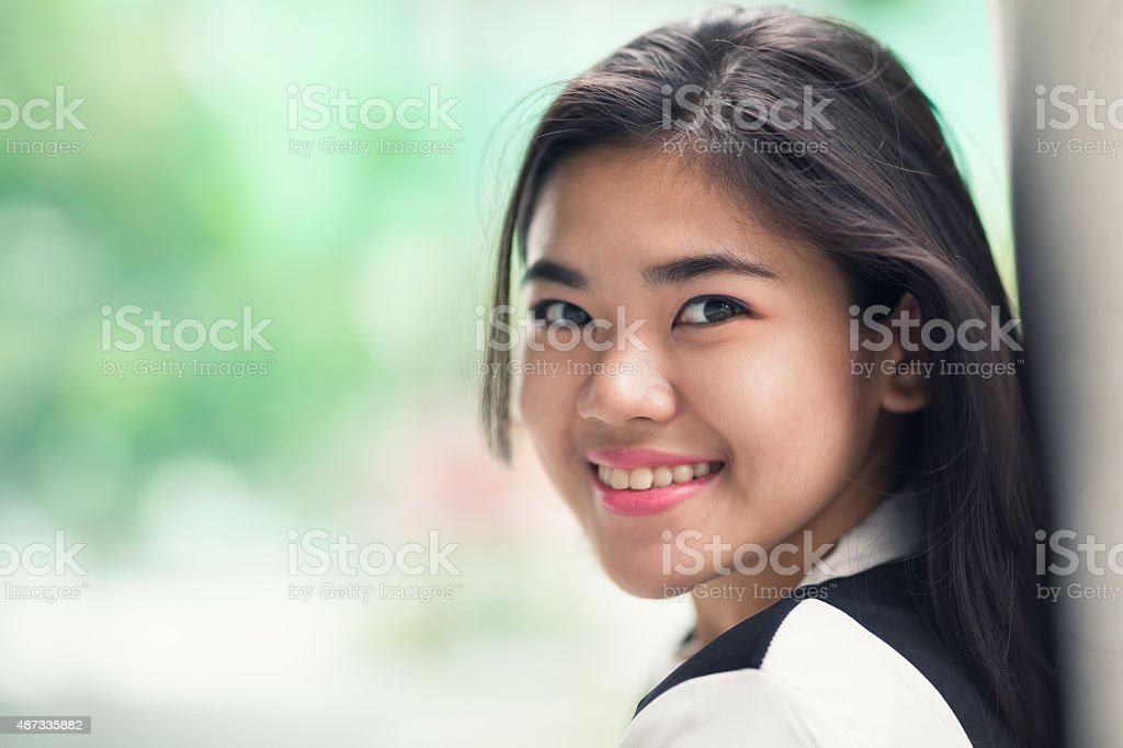Portrait of a young happy female student stock photo