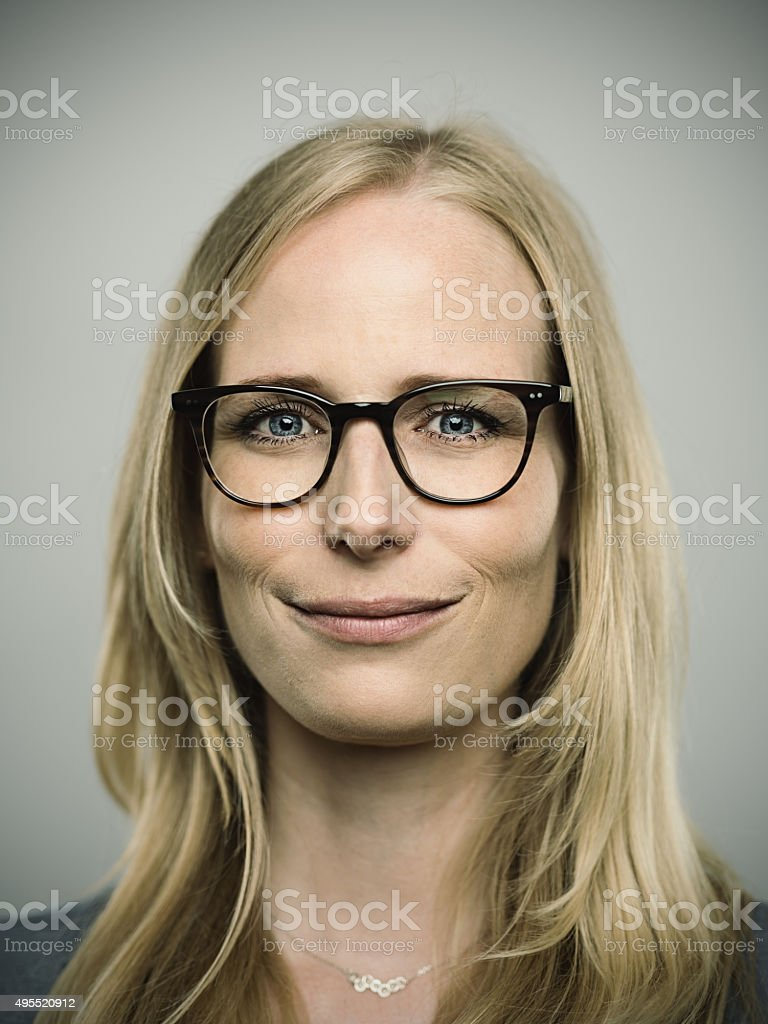 Portrait of a young happy german woman looking at camera stock photo