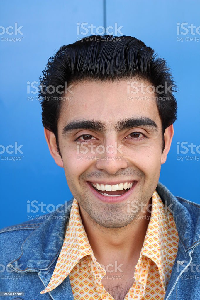 Portrait of a young Hispanic male smiling stock photo