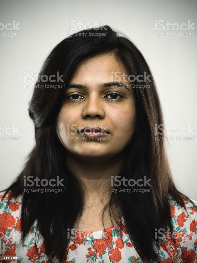 Portrait of a young indian woman looking at camera stock photo