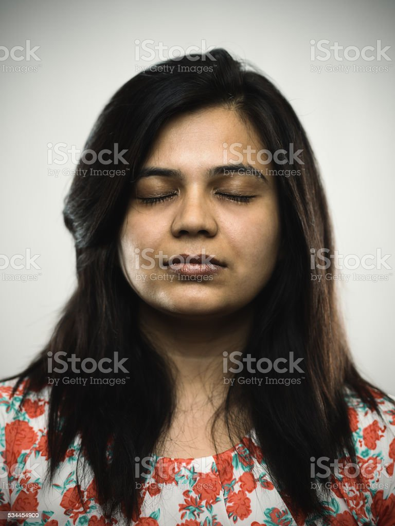 Portrait of a young indian woman with relaxed expression stock photo