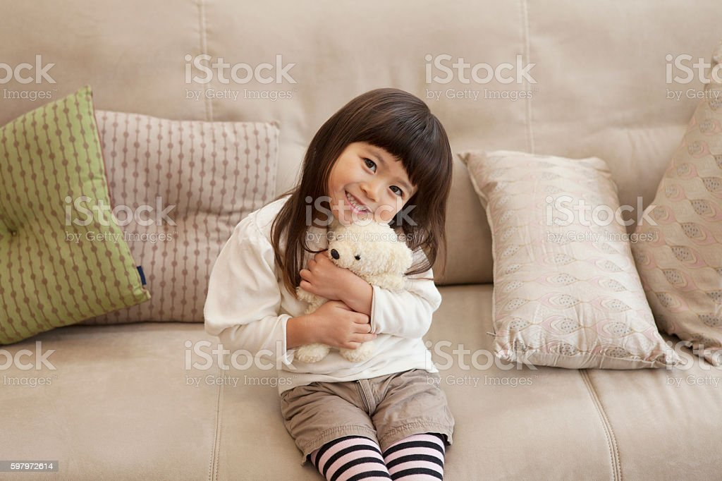 Portrait of a young Japanese girl holding a toy stock photo