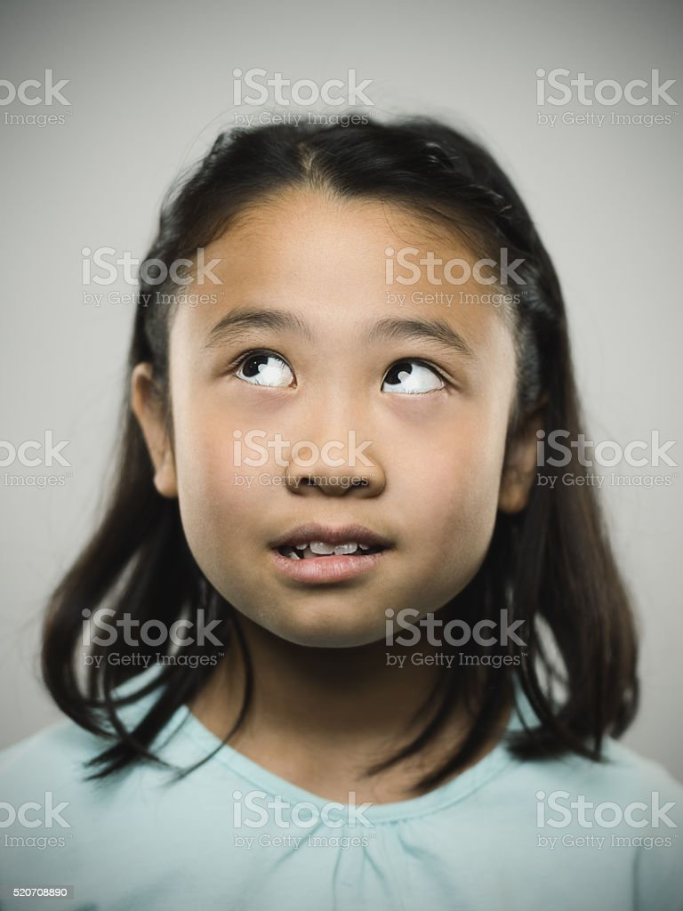 Portrait of a young japanese girl looking up. stock photo