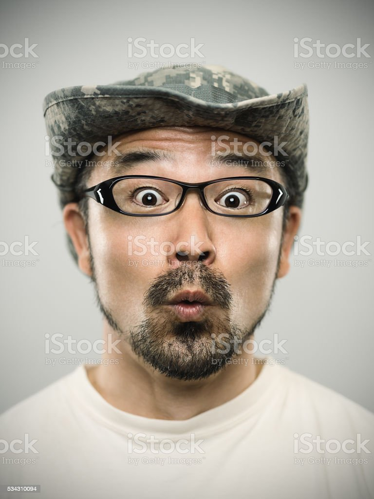 Portrait of a young japanese man looking at camera stock photo