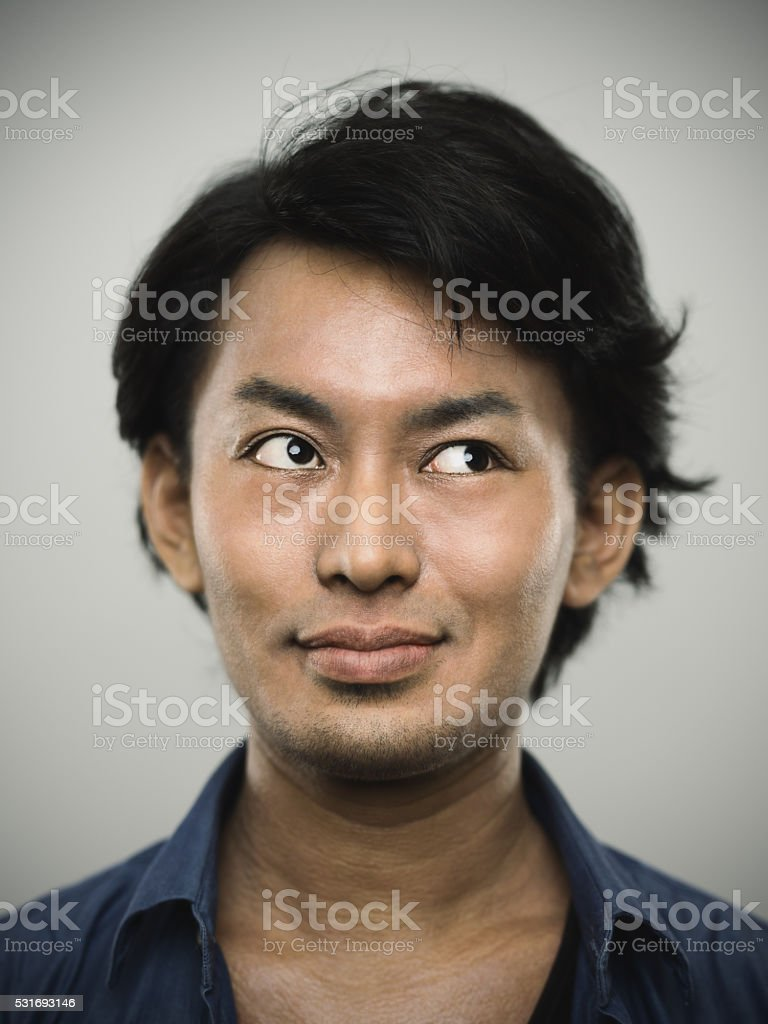Portrait of a young japanese man looking to the side. stock photo