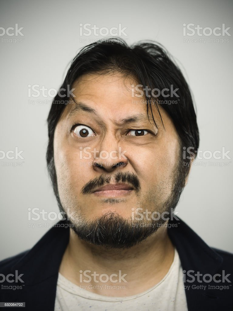Portrait of a young japanese man with angry expression stock photo