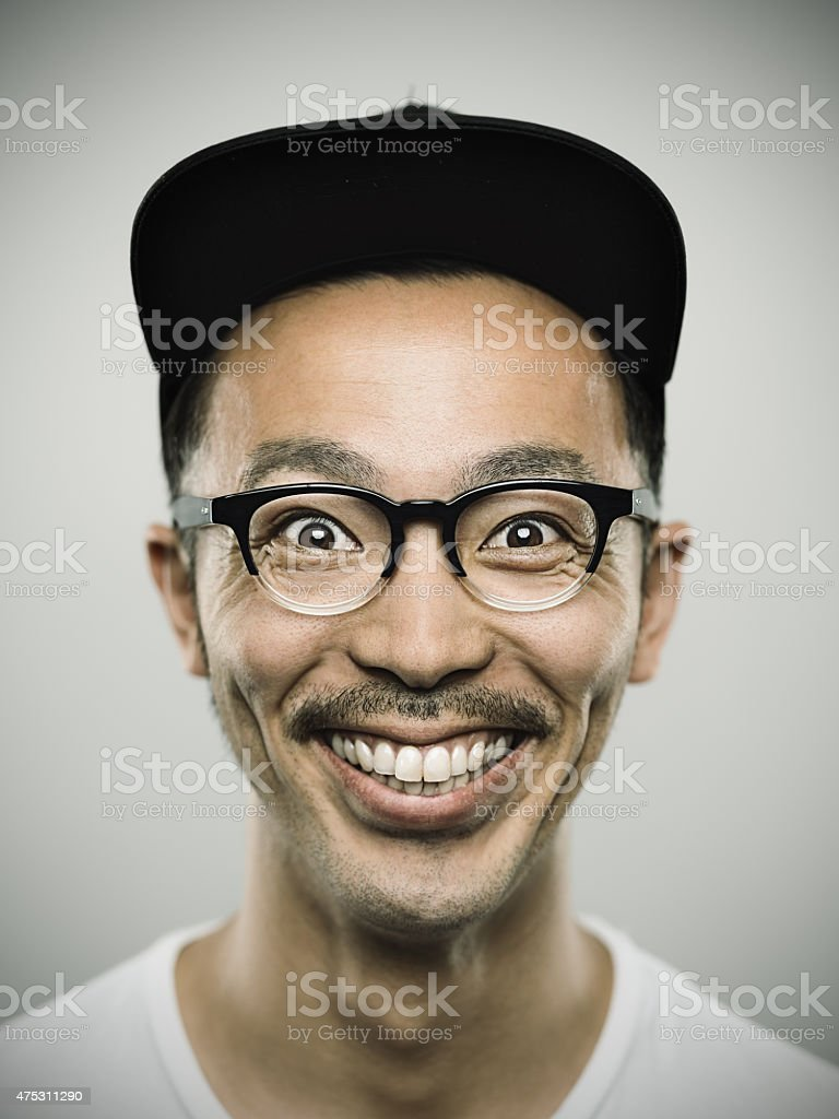 Portrait of a young japanese man with big smile stock photo