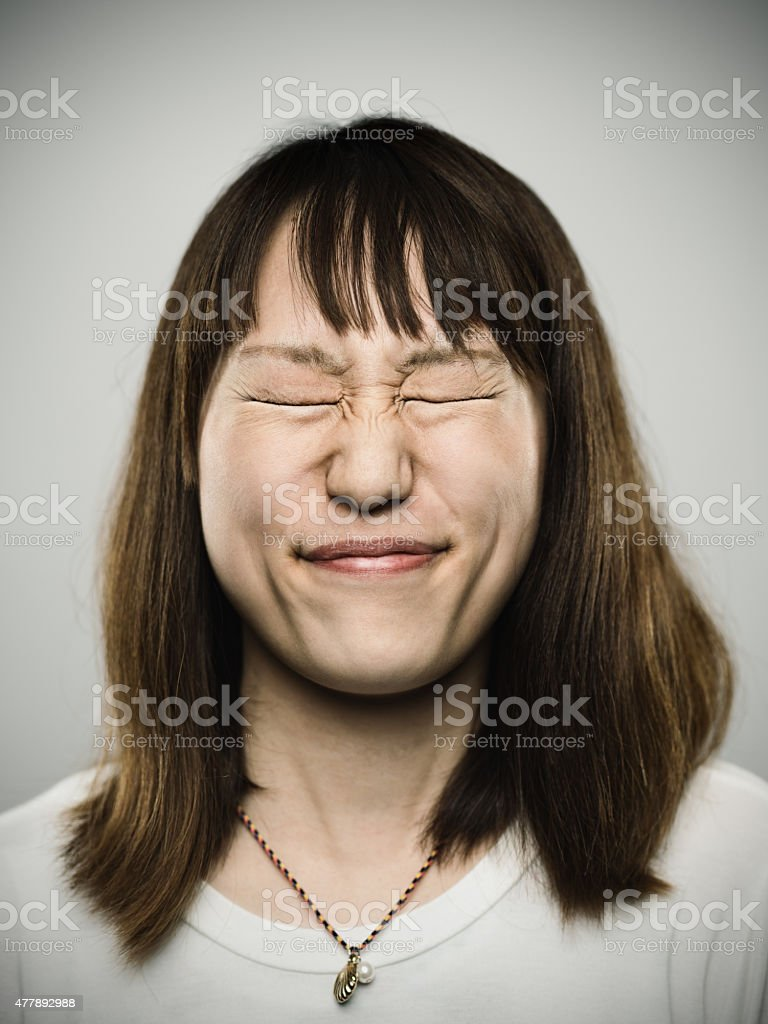 Portrait of a young japanese with closed eyes stock photo