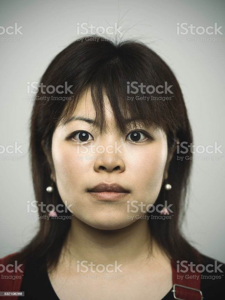 Portrait of a young japanese woman looking at camera stock photo