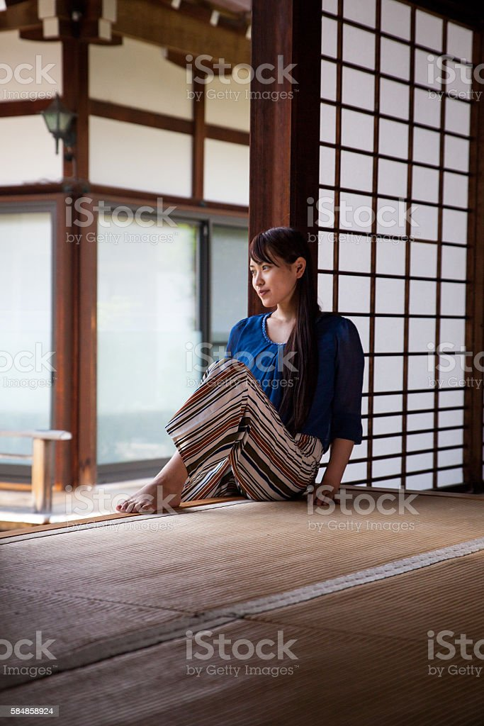 Portrait of a young japanese woman sitting and relaxing stock photo