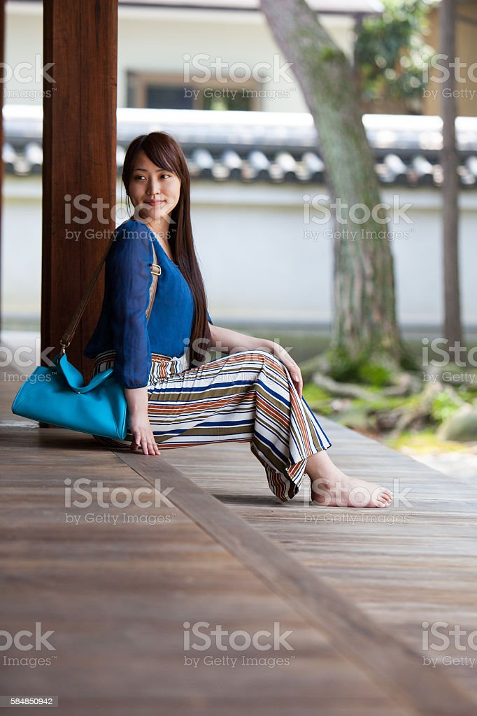 Portrait of a young Japanese woman sitting stock photo