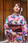Portrait of a Young Japanese Woman Wearing a Traditional Kimono