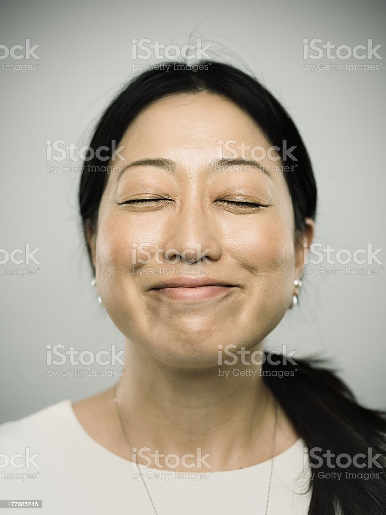 Portrait of a young japanese woman with happy smile stock photo