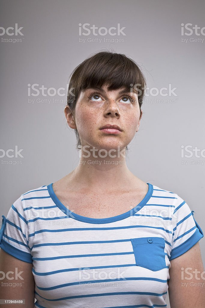 Portrait of a young lady looking up stock photo