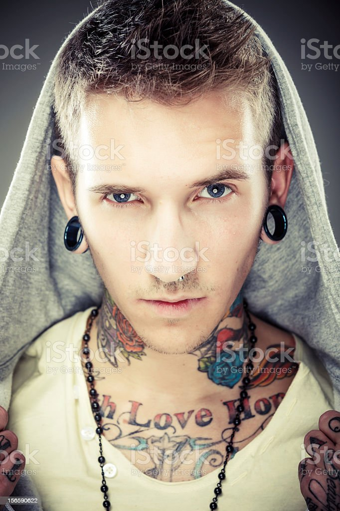 Portrait of a young male with many tattoos royalty-free stock photo