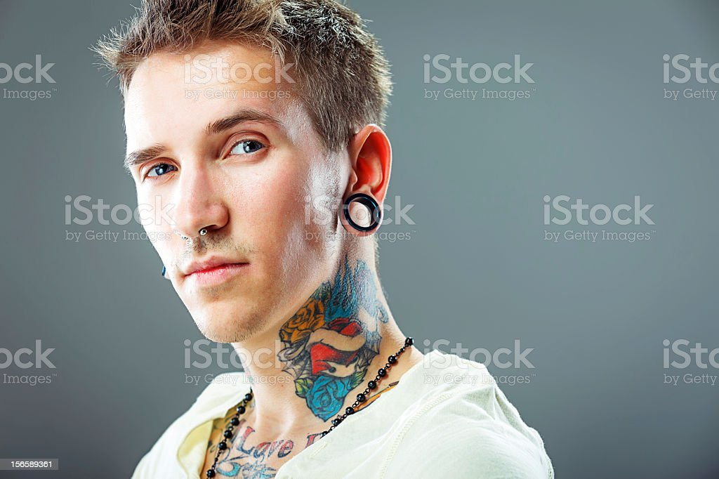 Portrait of a young male with tattoos stock photo