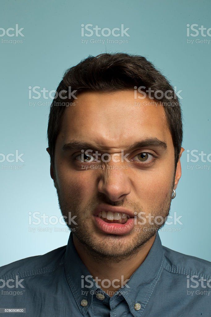 Portrait of a young man making funny face stock photo