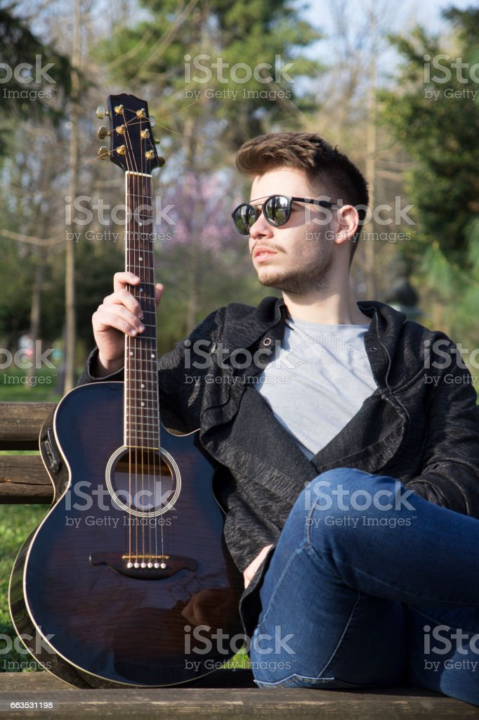 Portrait of a young man outdoors stock photo