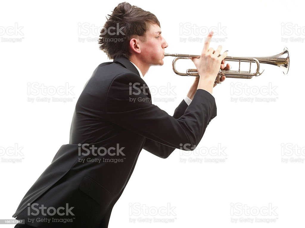 Portrait of a young man playing his Trumpet royalty-free stock photo