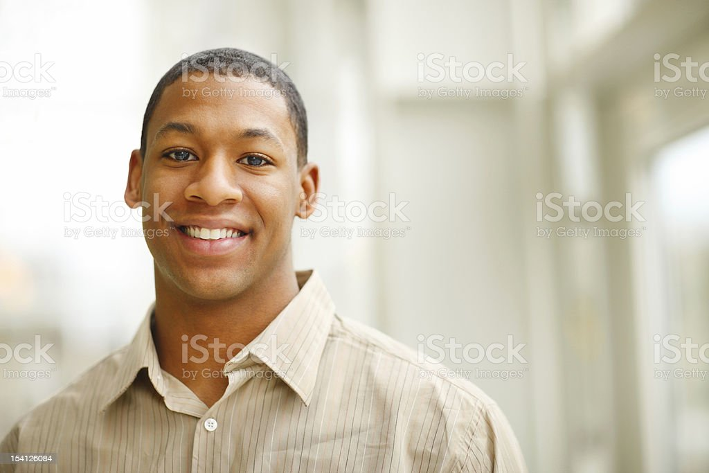 A portrait of a young man smiling at a camera royalty-free stock photo