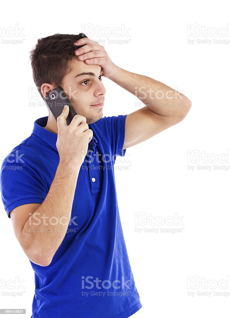Portrait of a young man talking on the phone stock photo