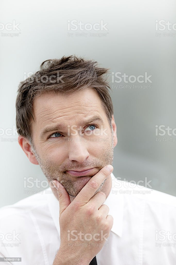 portrait of a young man thinking and looking away royalty-free stock photo