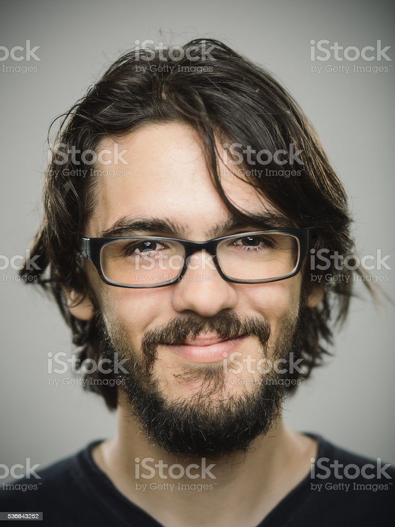 Portrait of a young man with glasses stock photo