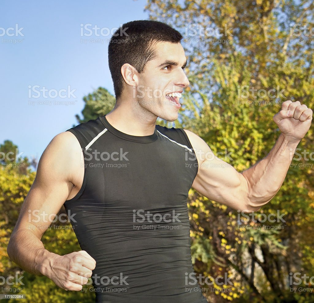 Portrait of a  young men celebrating win royalty-free stock photo
