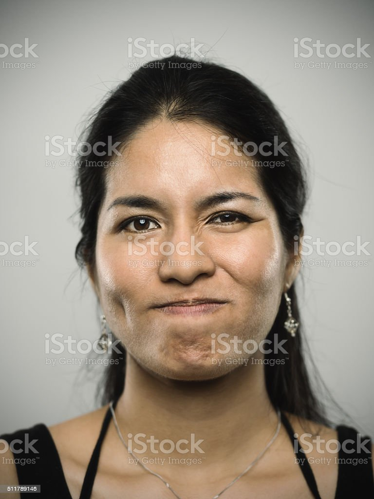 Portrait of a young mixed race woman looking at camera stock photo