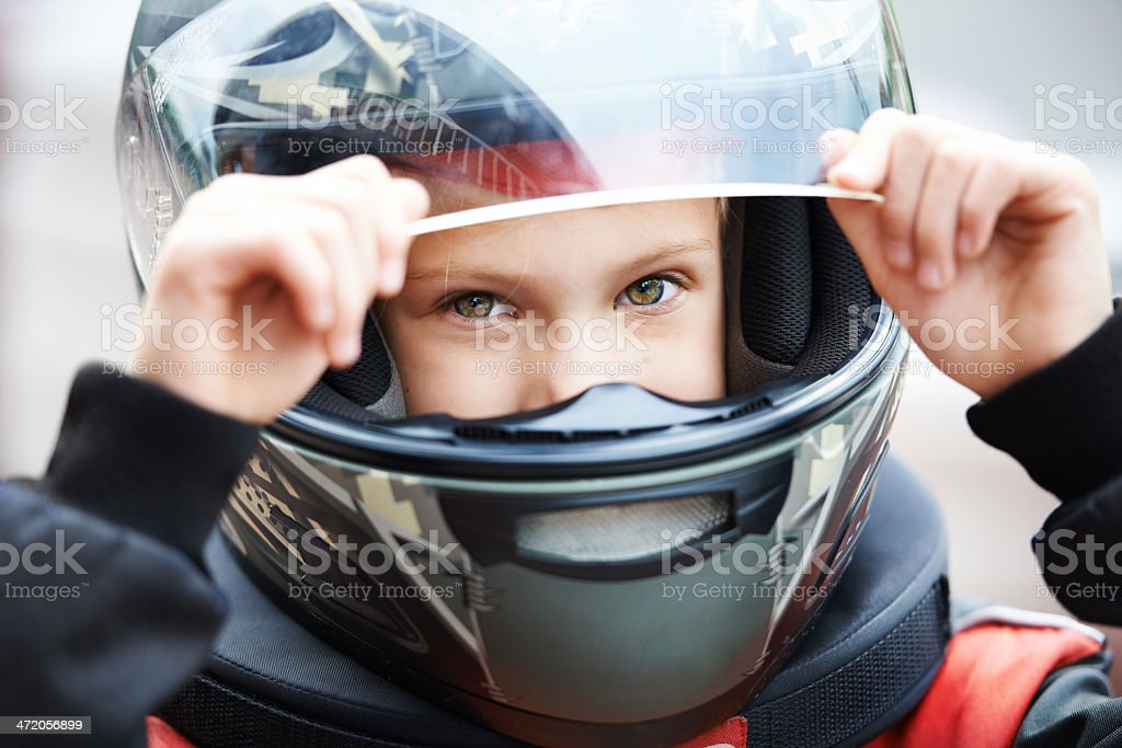 Portrait of a young racer in helmet stock photo
