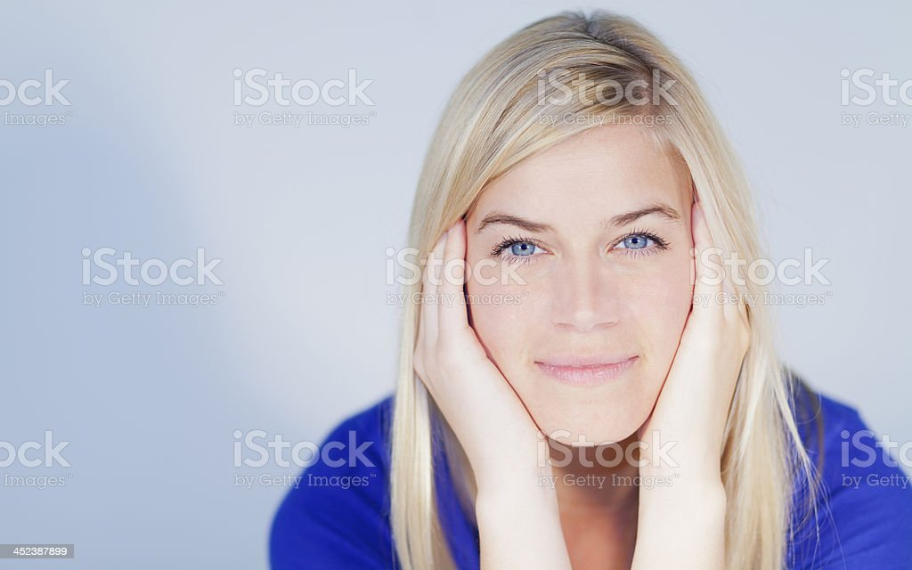 Portrait of a young relaxing woman looking at camera royalty-free stock photo