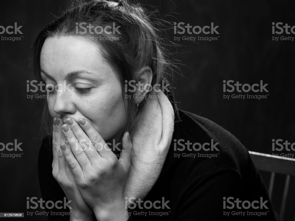 Portrait of a young sad woman stock photo