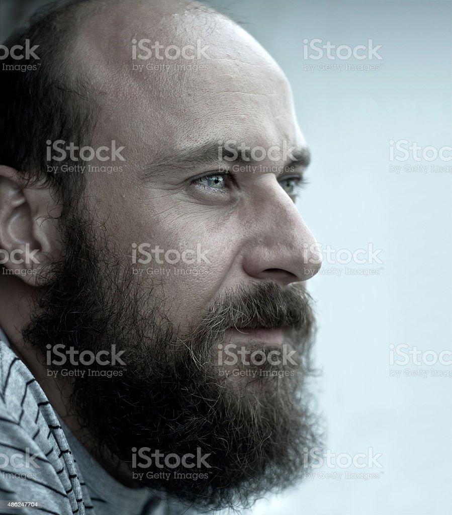 Portrait of a young serious man with beard stock photo