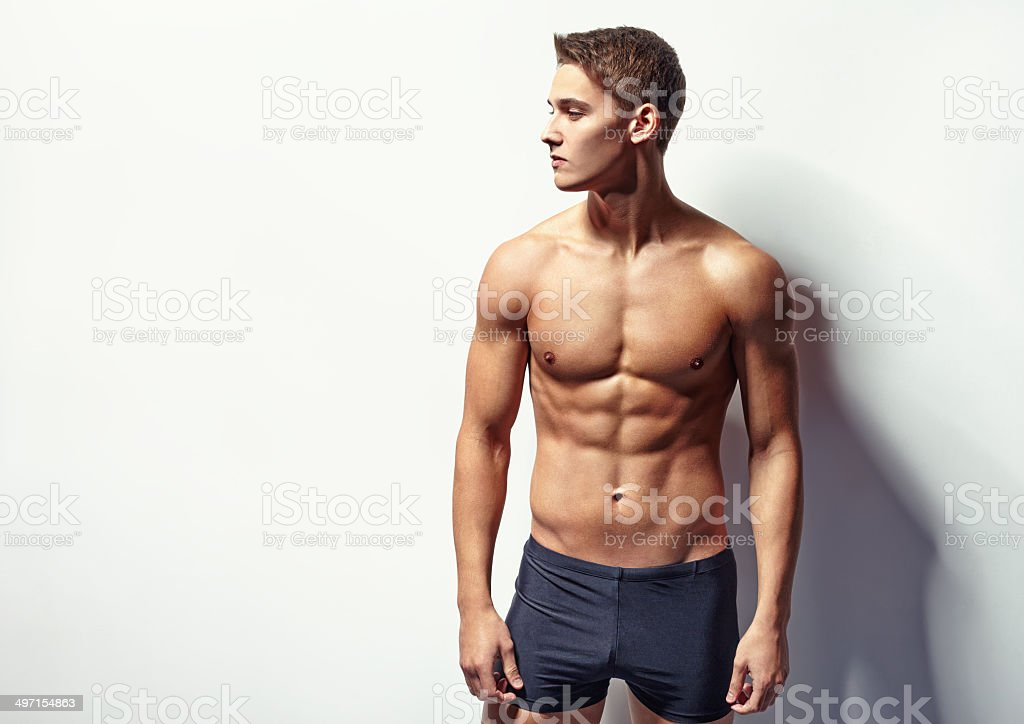 Portrait of a young sexy muscular man stock photo