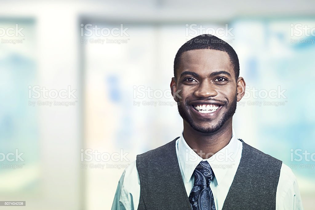 Portrait of a young smiling businessman stock photo