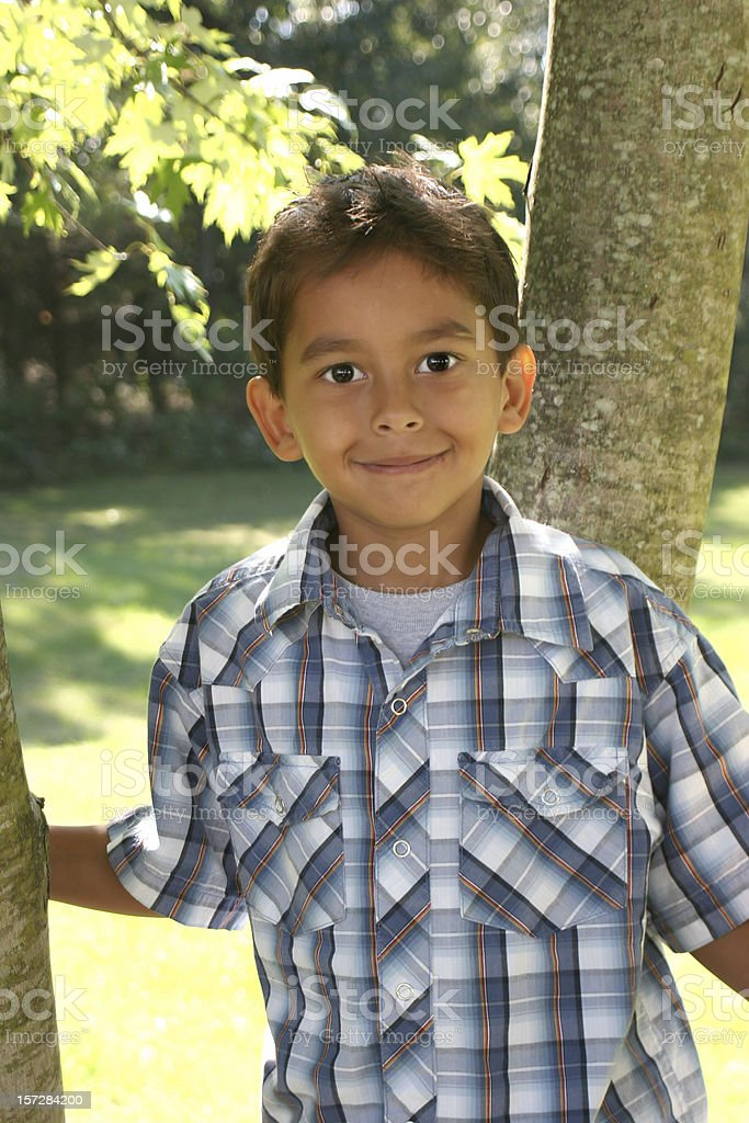 Portrait of a young smiling Hispanic boy outdoors royalty-free stock photo