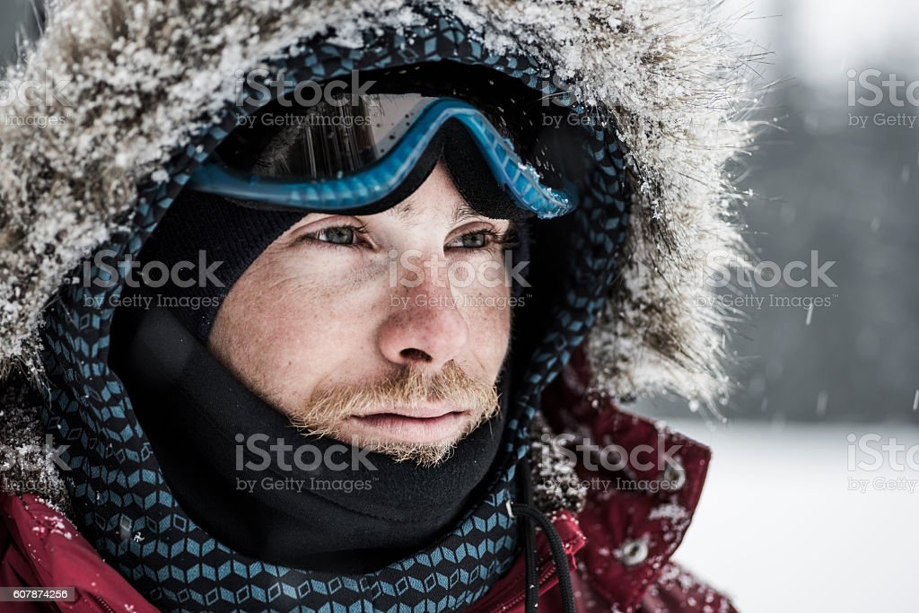 Portrait of a young snowboarder stock photo