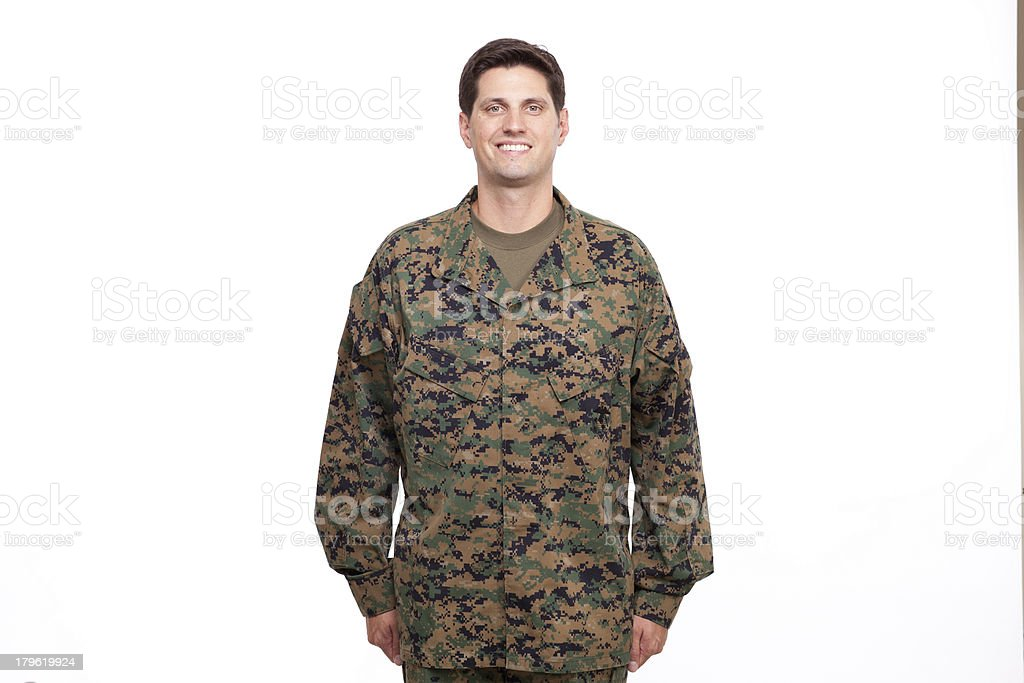 Portrait of a young soldier posing against white royalty-free stock photo
