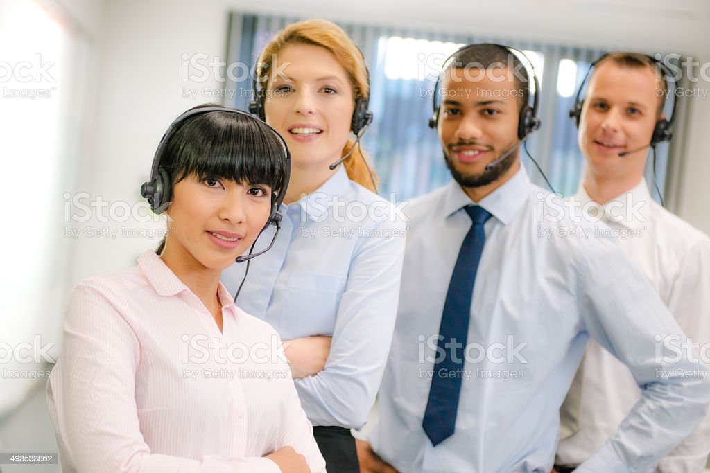 Portrait of a young team in customer support center stock photo