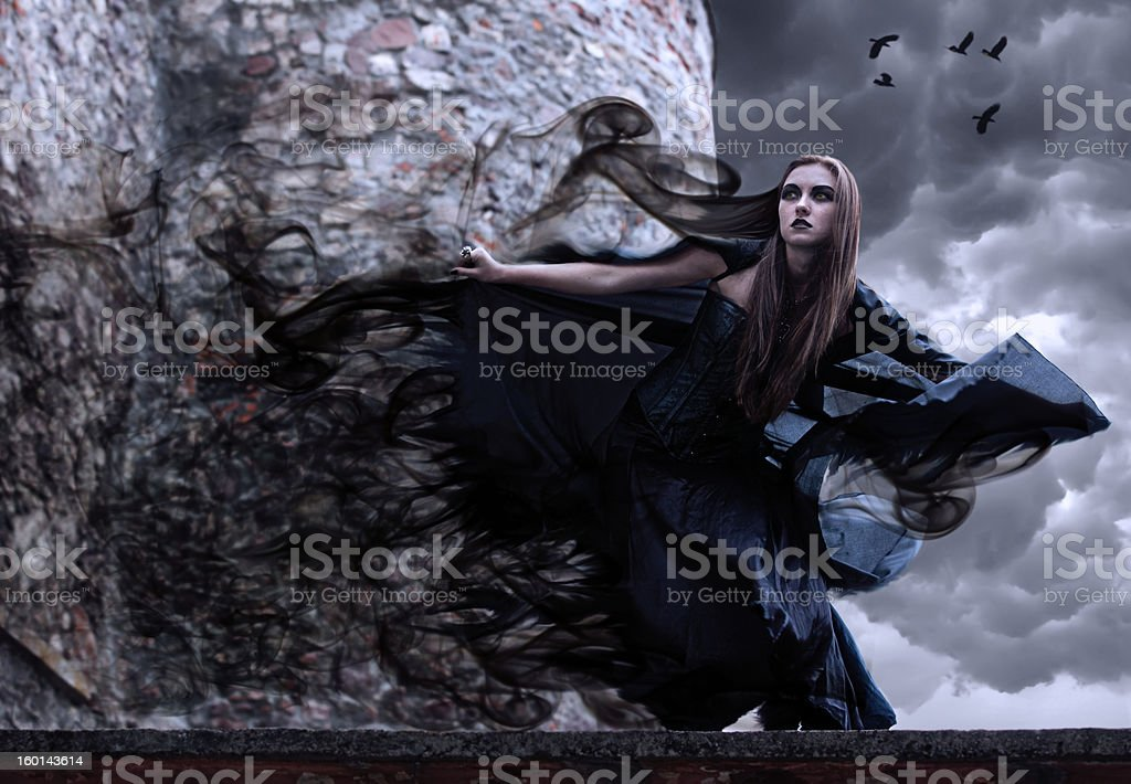 Portrait of a young witch. stock photo