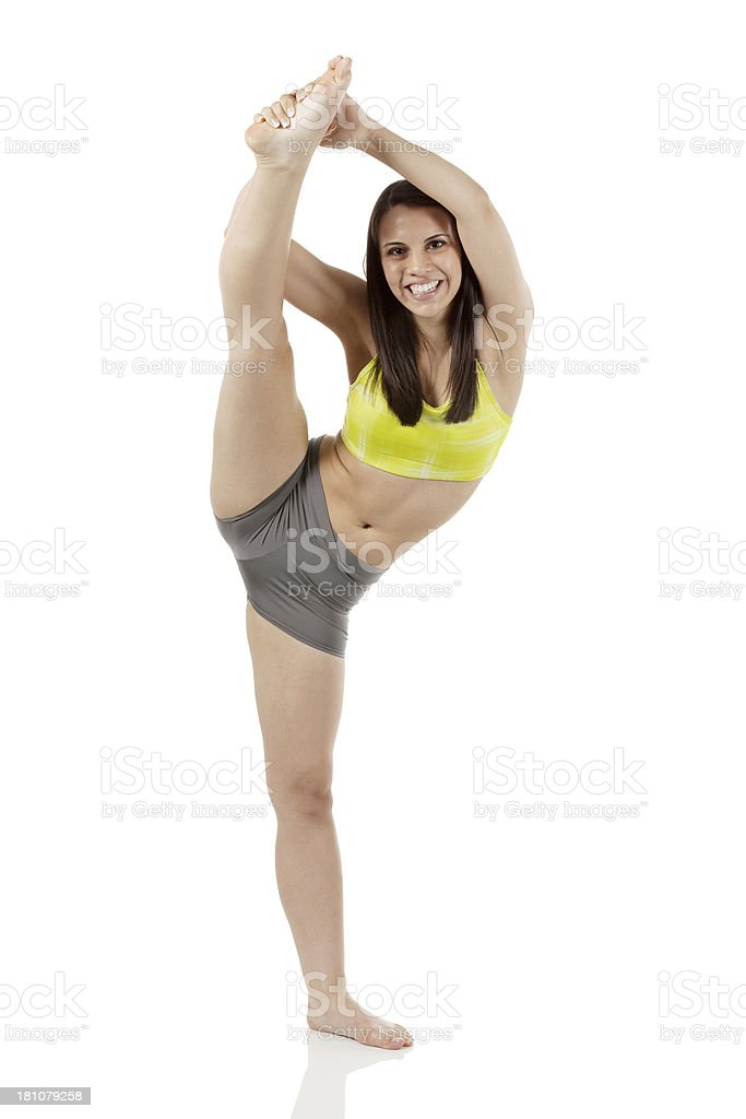 Portrait of a young woman doing stretching exercise royalty-free stock photo