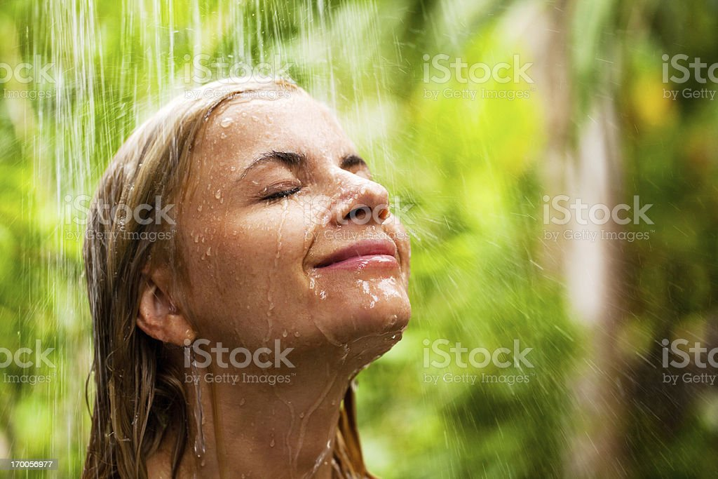 Portrait of a young woman during showering outdoor. royalty-free stock photo