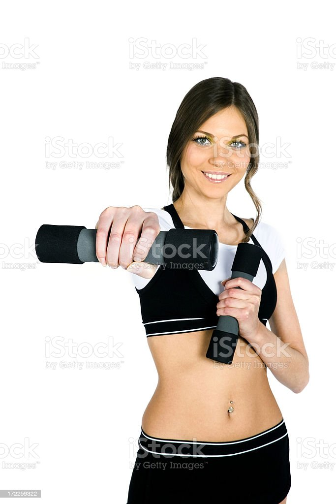 Portrait of a young woman exercising with dumbbells royalty-free stock photo
