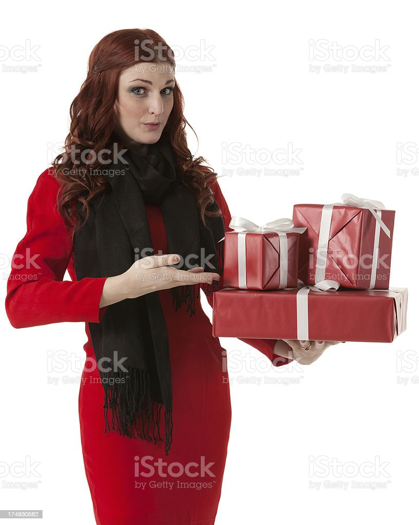 Portrait of a young woman holding Christmas presents royalty-free stock photo