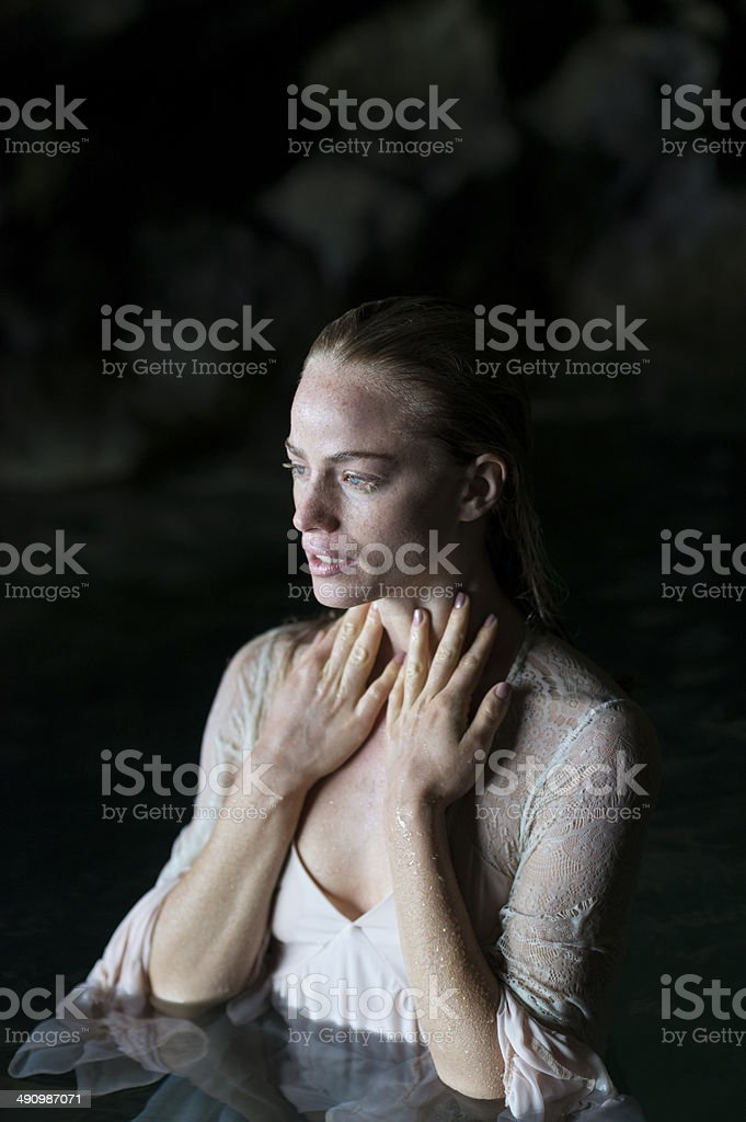 Portrait Of A Young Woman In A Natural Pool royalty-free stock photo